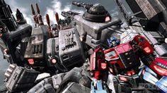 Transformers FOC Optimus standing In Metroplex hand
