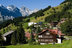 Mürren, Switzerland.  5,412 ft above sea level and unreachable by public road.  Village features view of three towering mountains, the Eiger, Mönch, and Jungfrau. Mürren has a population of just 450, but has 2,000 hotel beds.