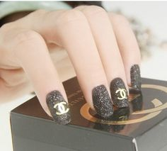 classic Chanel logo on black glittery nails!