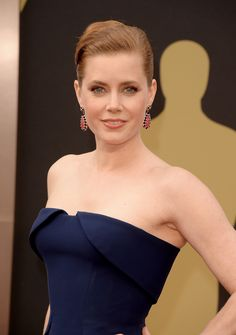 Amy Adams's slicked French roll and neutral makeup palette had a futuristic feel. #Oscars