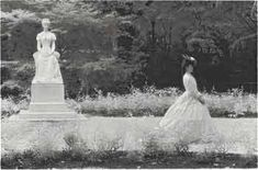 Empress Elisabeth out for a walk. After she turned 32 she did not allow anybody to take pictures or paint portraits of her, and she started wearing a black veil upon her face as a way to preserve the idea of her young beauty.