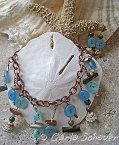 Buttons Galore tutorial by Carla  http://buttonsgaloreandmore.net/beachy-button-bracelet-set/