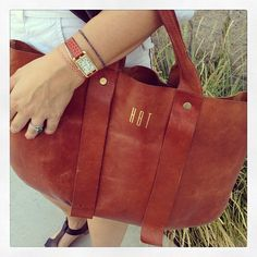 Loving this. Claire Vivier's monogrammed leather tote.