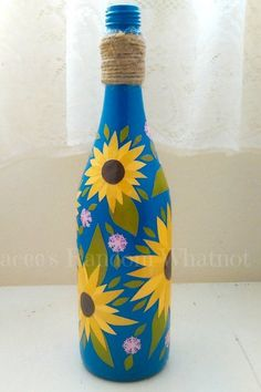 Created in the Winter, this wine bottle fulfilled my fantasies about the Summer season, with it's decoupaged sunflowers on a blue sky background! Wine Bottle Vases, Glass Bottle Crafts, Diy Bottle, Blue Bottle, Painted Glass Bottles, Painted Wine Glasses, Decorative Bottles, Pottery Painting Designs, Decoupage Vintage