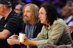 Tom Petty and Mike Campbell  watch the game between the Charlotte Bobcats and the Los Angeles Lakers at Staples Center on January 31, 2012 in Los Angeles,