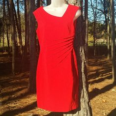 Caches red dress Perfect for Christmas! Solid red cache dress. Pic 2 shows rouched on side w/ side cut neckline. Thick material with stretch. Fully lined. Zipper in back.  Previously worn, great condition.  Self: 75% Rayon           14% Nylon            9% spandex Lining:            100% polyester Cache Dresses Midi