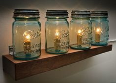 I just love mason jars. The closest thing we have here in Aust are Fowlers Jars. Vintage Blue Mason Jar Wooden Light Shelf (4 Jar Wall Mount). $195.00, via Etsy.
