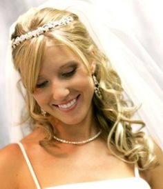 Beautiful wedding hairstyle with fringe and curly ends