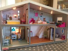 Redecoration of Lundby Gothenburg is complete - furniture has arrived and the Sylvanian Families have moved in!