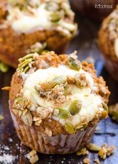 Whole Wheat Pumpkin Cream Cheese Muffins -- 100% whole wheat, sweetened with dates, filled with sweet cream cheese and topped with out of this world cinnamon pepita crumb topping.