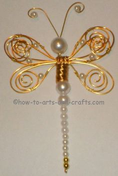Beaded dragonfly - one of the more craftsy takes on the subject, but the technique could be utilized with far more sophistication in a butterfly desing. Wire Wrapped Jewelry, Wire Jewelry, Beaded Jewelry, Jewelery, Handmade Jewelry, Bridal Jewelry, Beaded Crafts, Wire Crafts, Jewelry Crafts