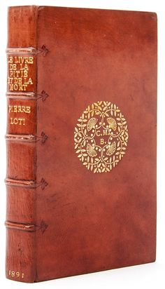 Loti (Pierre) Le Livre de la Pitié et de la Mort inscription to Constance Belliss on endleaf, niger morocco gilt by Douglas Cockerell, circular floral centrepiece on upper cover enclosing the owner`s initials, raised bands on spine extending onto covers as blind-tooled hinges, signed with monogram and dated 1898 inside lower cover, g.e., in fitted card case, 8vo, Paris, 1891.
