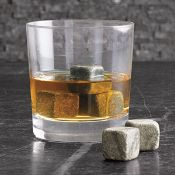 """""""Whiskey Stones""""- sit in the freezer and cool your beverage without diluting it.  Great idea!"""