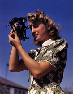 "September 1942. ""Learning how to determine latitude by using a sextant is Senta Osoling, student at Polytechnic High School, Los Angeles. Navigation classes are part of the school's program for training its students for specific contributions to the war effort."""