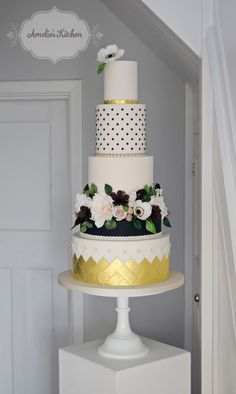 Five tier botanical and gold themed wedding cake with sugar roses, dahlias, anemone and berries