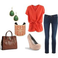 Love the emerald green earrings paired with the coral top.