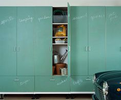 Shallow garage storage cabinets with labeled doors and drawers keep hobby and recreational items out of sight until they're needed. Items are grouped into general categories and assigned to a drawer or shelf behind closed doors.