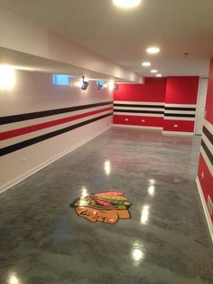 Chicago sports themed man cave painting. I dont want a hawks room, itd be the Wild obviously,  but I like the idea of using the stripes.