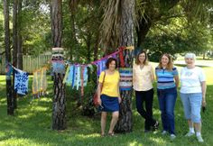 The friends who created and installed my surprise fabric   bombing. I love it!  More images at http://adventurequilter.com/blog/2013/05/fabric-bombing-details/