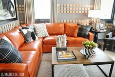 Love this Ethan Allen orange leather couch!