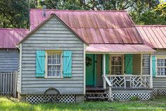 "Gullah Home with Haint Blue Shutters Daufuskie Island South Carolina ""Known as the Gullah or Geechee people the original Haint Blue creators were descendants of African slaves who worked on rice plantations in South Carolina and Georgia. Many of their ancestors came from Angola which may be where the name Gullah originated. Haints or haunts are spirits trapped between the world of the living and the world of the dead. Legend says these angry spirits cannot cross water. The safest place would…"