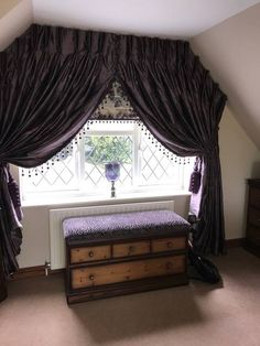 Dramatic window treatment by Curtain Elegance.
