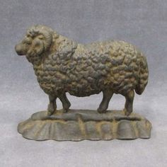 VINTAGE CAST IRON RAM DOOR STOP