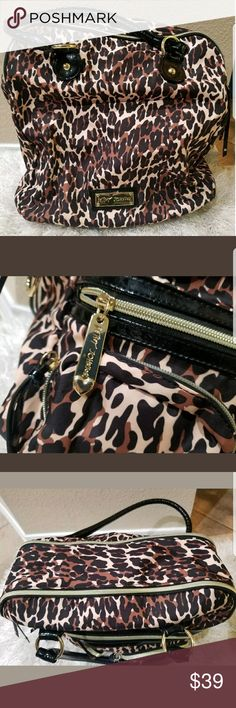 """Betsey Johnson Leopard Print Purse Handbag Betsey Johnson Leopard Print Purse Handbag  Condition - Pre-owned no stains in good condition. Does not come with cross body handle.  Bag has total of 3 pockets. Two in front and one inside. Bag opens on two different sides.  Great for everyday use!  Height - 14"""" Length - 13""""  Thanks for looking!  Be sure to check out my EBay Store! Betsey Johnson Bags"""