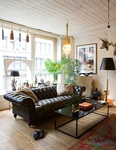 Loft living room with leather chesterfield, love this rug