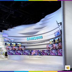 """We called this gigantic 87-foot entrance to Samsung's exhibit at the Consumer Electronics Show the """"canyon."""" The entrance mirrored the shape of the world's first curved Ultra High Definition TV launched at the show. Thirty curved UHD monitors displayed computer controlled content from Samsung."""