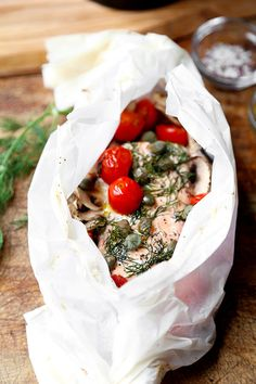 Salmon En Papillote - A delicious and easy to make Salmon En Papillote Recipe that looks refined, but is so simple you can get it on your family's dinner table in 30 minutes!