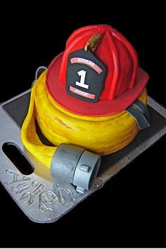 Fire helmet and hose grooms cake - So adorable! This would be great to do something in a police theme for Francis