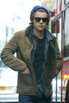 Sack the stylist: Harry can't seem to be torn away from his beloved brown sheepskin jacket