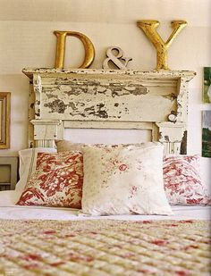 OH MY HECK i love the idea of a mantle as a headboard! now, where can i find an old house filled with old treasures, just waiting for me...