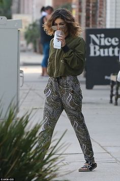 Looked terrific: She wore a stylish olive green bomber jacket with zipper pockets and blac...
