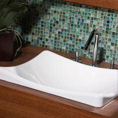 Bathroom backsplash -Check out this American Olean product: Photo features Visionaire in Peaceful Sea 5/8 x 5/8 mosaic.