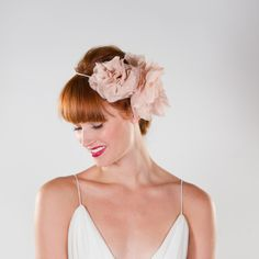 Swooning over this romantic floral hairpiece. #CamilleStyles