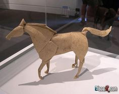 Amazing origami by  Akira Yoshizawa. There are many other amazing pieces on this page as well - check them out!