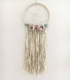 A personal favorite from my Etsy shop https://www.etsy.com/ca/listing/544420595/9-white-pink-floral-dream-catcher