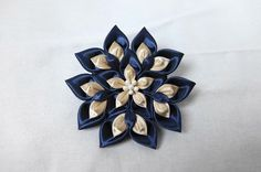 Brooch of star crystal.Navy and gold satin fabric.