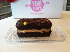 Yum Yums Peanut Butter Brownie.  Two triple chocolate brownies sandwiched around a healthy layer of peanut butter with peanut butter M&M's.  Add Kahlua and ice cream.   yumyumstogo.com