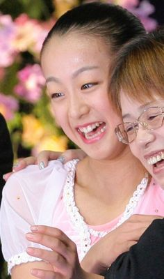"Mao, in cuddles, hugging with her then Coach Machiko Yamada, at the ""Kiss and Cry"" after realizing she had WON her first Senior GPF (Grand Prix Final) Championship in her Debut Year!!! ・ Dec. 17, 2005 ・Grand Prix Final of Figure Skating 2005 ・"