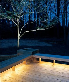 Creating the ultimate outdoor oasis - outdoor lighting under benches for a warm glow. love!