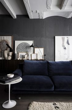 Dark walls and dark floors with a dark couch...