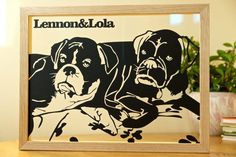 Lennon's & Lola portrait papercut. Redrawn from a photo, cut from paper and sandwiched between 2 sheets of glass inside a floating frame