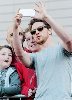 James McAvoy taking a selfie with fans in Manchester, United Kingdom.