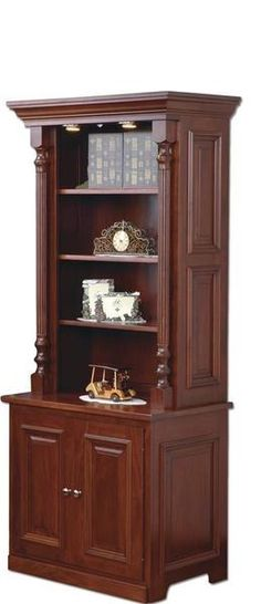 Amish Wilmot Bookcase Rich and elegant, the Wilmot makes an impression! Enjoy solid wood shelves with lots of display space as well as a lower cabinet for storage.