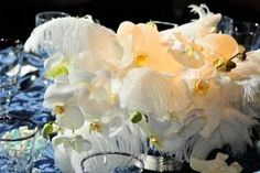 Phalaenopsis and ostrich feathers filled arrangements. – in Gershwin's 'Rhapsody in Blue' Inspires L.A. Phil's '30s-Style Gala
