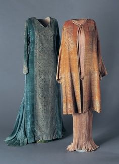 """Mariano Fortuny (Spanish, 1871-1949): (from left to right) long gown of silk velvet - 1930's, """"Delphos"""" Dress of pleated silk - 1920's, jacket of silk velvet - 1930's. """"Although modern and original, these creations are inspired by Classical Greek and medieval clothing. Fortuny produced the dyes, stencils and all of the machines that made the clothing in his studio at the Palazzo Orfei in Venice. Every piece of the garment was handmade, even the labels..."""""""