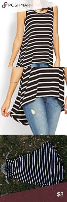 Striped High Low Top This forever 21 black and white striped tank top is both comfortable and stretchy. The front does curve up and drops down in the back. One of its perks is that it's not a tank top to wrinkle bad. Forever 21 Tops Tank Tops